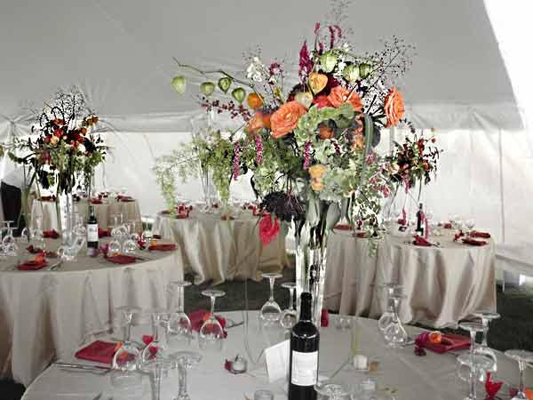 many votive candle lights extended the autumn tall wedding centerpieces